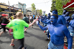 The Blue Man Group greets fellow joggers on Divisidero at the 107th running of the Bay to Breakers, Sunday, May 20, 2018, in San Francisco. (Photo by D. Ross Cameron)