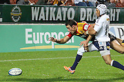 Chiefs Richard Kahui try's to dive on the ball,but gets push by Gio Aplon, which lead to a penalty try to the Chiefs,during the Investec Super 15 Rugby match, Chiefs v Stormers, at Waikato Stadium, Hamilton, New Zealand, Saturday 14 May 2011. Photo: Dion Mellow/photosport.co.nz