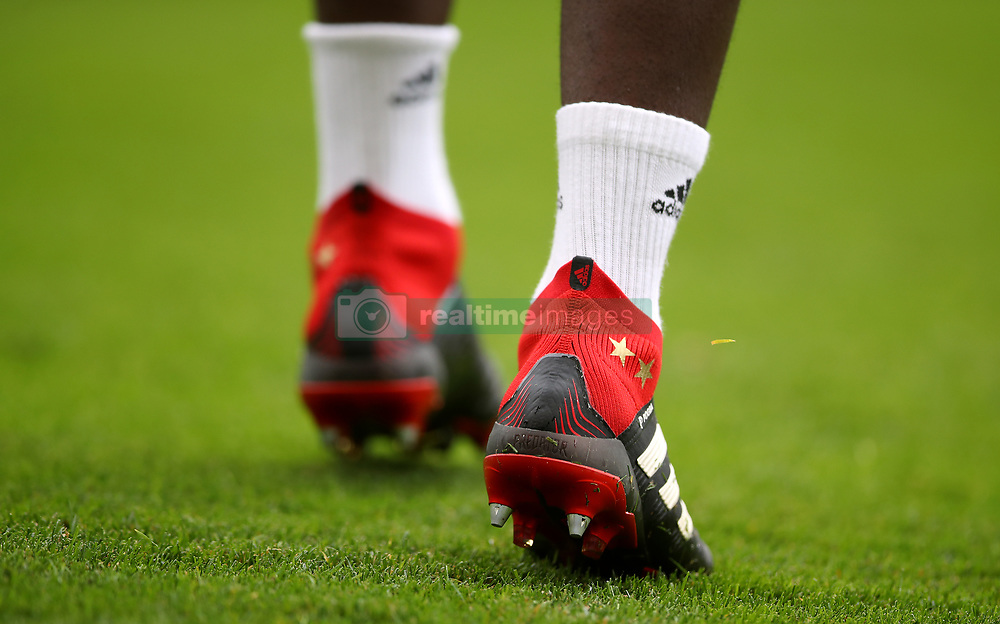 Close up of Manchester United's Paul Pogba boots with two stars for his recent World Cup win with France