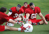 Marist linebacker Paul Satkowski (56) leads a group of players in stretching at the end of the team's first practice on Friday, Aug. 9, 2013, in Poughkeepsie.