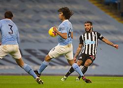 DeAndre Yedlin of Newcastle United (R) has a shot at goal - Mandatory by-line: Jack Phillips/JMP - 26/12/2020 - FOOTBALL - Etihad Stadium - Manchester, England - Manchester City v Newcastle United - English Premier League