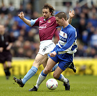 Photo: Richard Lane.<br /> Reading v West Ham United. Nationwide Division One. 03/04/2004.<br /> Ricky Newman holds off David Connolly.