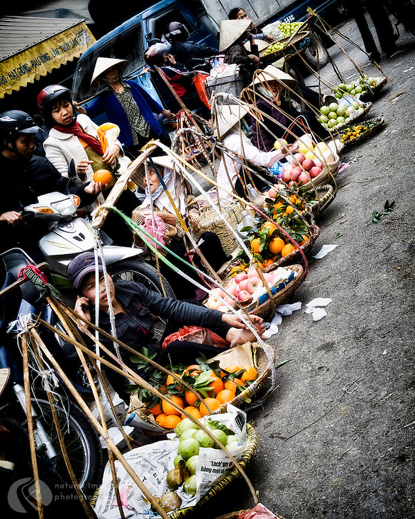 These Hanoi women start the day with their baskets of fruit, selling up and down their section of town until their fruit is gone and the day is done.