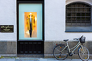 Window display of R. Junghans leather fashion clothing shop in Burgstrasse in Munich, Bavaria, Germany