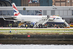 © Licensed to London News Pictures. 10/10/2019. London, UK. An Extinction Rebellion protester believed to be former paralympic athlete James Brown on top of a British Airways plane at London City Airport. Protesters planned to occupy the terminal building in a 'Hong Kong-style' shutdown as part of ongoing protests calling on government departments to tackle the Climate Emergency. Photo credit: Rob Pinney/LNP