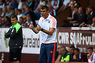 Brentford Manager Marinus Dijkhuizen gives the thumbs up to his players. Skybet football league championship match, Burnley  v Brentford at Turf Moor in Burnley, Lancs on Saturday 22nd August 2015.<br /> pic by Chris Stading, Andrew Orchard sports photography.
