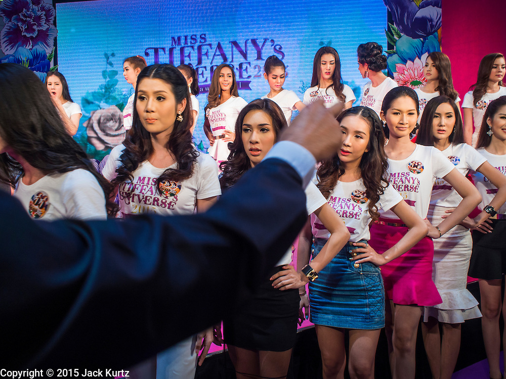 25 MARCH 2015 - BANGKOK, THAILAND: Contestants get their stage direction before the first round of the Miss Tiffany's contest at CentralWorld, a large shopping mall in Bangkok. Miss Tiffany's Universe is a beauty contest for transgender contestants; all of the contestants were born biologically male. The final round will be held on May 8 in the beach resort of Pattaya. The final round is televised of the  Miss Tiffany's Universe contest is broadcast live on Thai television with an average of 15 million viewers.     PHOTO BY JACK KURTZ