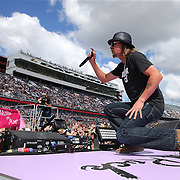 Kid Rock performs ahead of the 57th Annual NASCAR Daytona 500 race at Daytona International Speedway on Sunday, February 22, 2015 in Daytona Beach, Florida.  (AP Photo/Alex Menendez)
