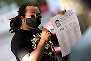 A demonstrator prepares a speech of the civilians killed during the AFP Stop Training Killers protest organised by Make West Papua Safe organisation. The organisation believes the AFP trains with Indonesian riot police BriMob and counter-terrorist police D88, who are reportedly notorious killers in West Papua, responsible for execution-style murders, torture and other crimes. (Photo by Mikko Robles/Speed Media)