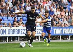 Derby County's Tom Lawrence (left) and Reading's Liam Kelly (right) battle for the ball