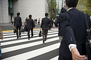 businesspeople rushing across a pedestrian crossing Tokyo Japan