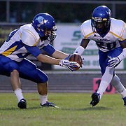 Laney High School's Jared Kelly, left and Imeek Watkins handle a kick-off return against Ashley High School Friday at Ashley High School. (Jason A. Frizzelle)