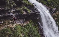 THEMENBILD - eine Frau auf einem Weg hinter dem Wasserfall waehrend einer Wanderung entlang des Wasserfallweges, aufgenommen am 28. Juli 2019 in Fusch a. d. Grossglocknerstrasse, Oesterreich // a woman on a trail behind the waterfall during a hike along the waterfall trail in Fusch a. d. Grossglocknerstrasse, Austria on 2019/07/28. EXPA Pictures © 2019, PhotoCredit: EXPA/ JFK