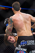 DALLAS, TX - MARCH 14:  Elias Theodorou punches Roger Narvaez during UFC 185 at the American Airlines Center on March 14, 2015 in Dallas, Texas. (Photo by Cooper Neill/Zuffa LLC/Zuffa LLC via Getty Images) *** Local Caption *** Elias Theodorou