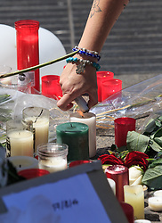 (170818) -- BARCELONA, Aug. 18, 2017 (Xinhua) -- People mourn victims of the terror attack on Las Ramblas area, Barcelona, Spain, on Aug. 18, 2017. At least 14 died in Thursday's double terror attacks in Spain, as Spanish people demonstrated defiance and condolences by leaders of the world poured in on Friday. (Xinhua/Xu Jinquan)  (Photo by Xinhua/Sipa USA)