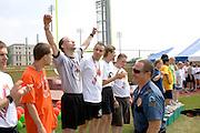 Exuberant athlete wearing 1st place medal. Special Olympics U of M Bierman Athletic Complex. Minneapolis Minnesota USA