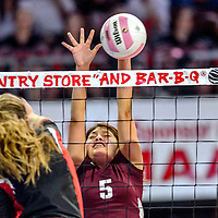 Tohatchi Cougar Cheyenne Begay (5) blocks a Eunice Cardinal spike during the state volleyball tournament at the Santa Ana Star Center in Rio Rancho  Friday.