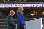 Supported by her husband, Gabby Giffords speaks at the 2016 DNC