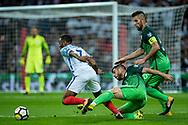 England (7) Raheem Sterling, Slovenia (5)Bosijan Cesar during the FIFA World Cup Qualifier match between England and Slovenia at Wembley Stadium, London, England on 5 October 2017. Photo by Sebastian Frej.