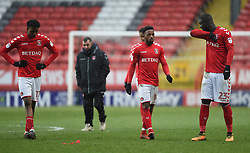 Left to right: Charlton Athletic's Joe Aribo, Tarique Fosu and Mouhamadou-Naby Sarr walk off the pitch dejected at full time