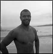 Kurtley Beale at Bondi Beach 2014 smiling after a morning swim. Large Format Black and White photo. Kurtley Beale<br /> Rugby Player<br /> Kurtley Beale is an Australian representative rugby union player of Aboriginal descent. He usually plays at Fly-half or Fullback, but can play Inside Centre and Wing. Beale is one of the most exciting players in world rugby with miraculous ball skills and speed. ©Paul Green