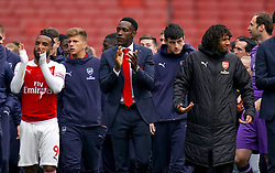 Arsenal's Danny Welbeck (centre) applauds the fans after the final whistle of the Premier League match at the Emirates Stadium, London.