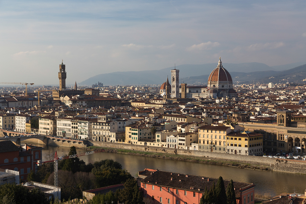 Cathedral in Florence, Italy. The Cathedral, Baptistery and Giotto's Campanile form the cathedral complex in Piazza del Duomo. These three buildings are part of the UNESCO World Heritage Site covering the historic center of Florence and are a significant tourist attraction of Tuscany.