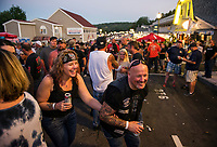 Biketemberfest revelers enjoying the street party scene at Weirs Beach on Saturday night.  (Karen Bobotas/for the Laconia Daily Sun)