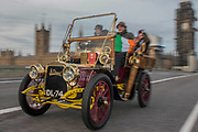 Going over Westminster Bridge - Bonhams London to Brighton Veteran Car Run celebrates the 122nd anniversary of the original Emancipation Run of 1896 which celebrated the passing into law the Locomotives on the Highway Act so raising the speed limit for 'light automobiles' from 4mph to 14mph and abolishing the need for a man to walk in front of all vehicles waving a red flag. The Movember Foundation as our Official Charity Partner.