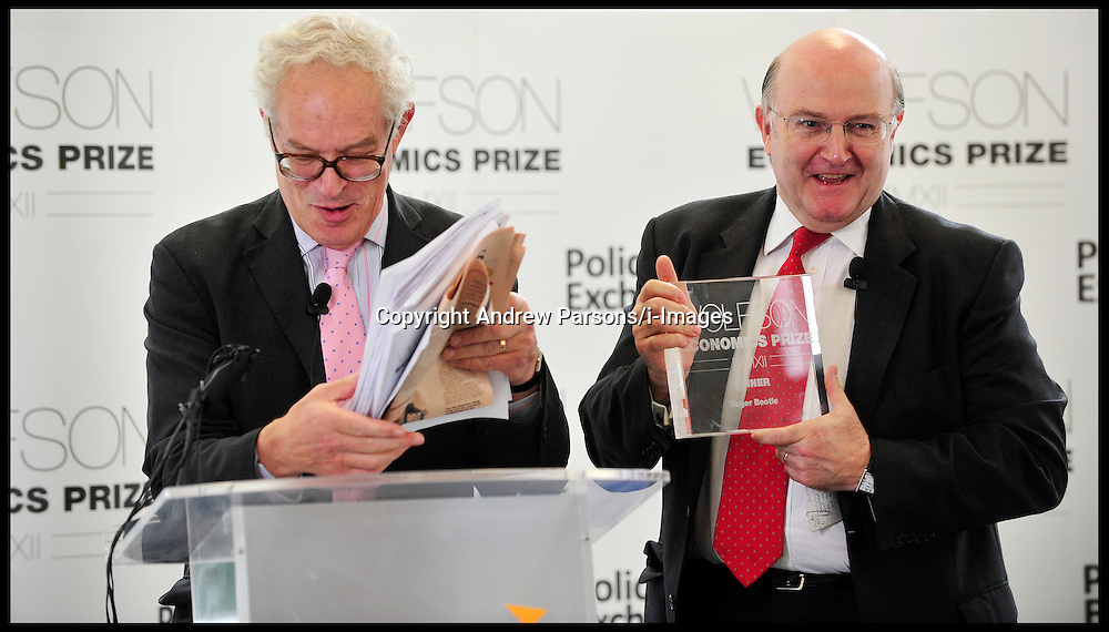 Professor Charles Goodhart announces the winner of the Wolfson Prize Roger Bootle from Capital Economics (red Tie,glasses), Thursday July 5, 2012. Photo by Andrew Parsons/i-Images.All Rights Reserved ©Andrew Parsons/i-Images.See Instructions
