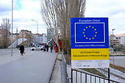 The sign to the EU funded rebuilt Mitrovica bridge, over the river Ibar which separates the Serbian and Albanian districts of Mitrovica, Kosovo on the 12th of December 2018. Mitrovica or Kosovska Mitrovica is a city and municipality located in Kosovo. Settled on the banks of Ibar and Sitnica rivers, the city is the administrative center of the Mitrovica District.