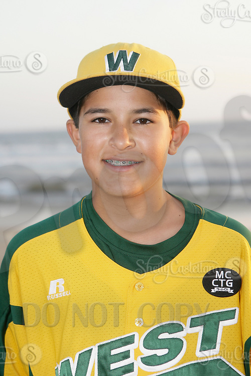 26 September 2011: #22 Anthony Martinez 2011 Little League Baseball World Series Championship team portrait northside of the Huntington Beach Pier at sunset in Southern California.  Ocean View team WEST beat Hamamtsu City, Japan, 2-1, to become the seventh team from California to win the title on August 28, 2011 in South Williamsport, PA.