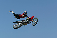 """Jul 01, 2003; Anaheim, California, USA; Moto X star athlete MIKE METZGER executing a tremendous stunt feet free with a full sized motobike over at the opening of Disney's California Adventure """"X Games Experience"""".  Disney park has built two X-Arena's specifically for this 41 day event highlighting extreme sports for the launch of the 2003 ESPN X Games.<br />Mandatory Credit: Photo by Shelly Castellano/Icon SMI<br />(©) Copyright 2003 by Shelly Castellano"""