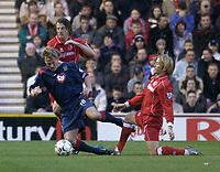 Photo. Glyn Thomas.<br /> Middlesbrough v Portsmouth. FA Barclaycard Premiership.<br /> Riverside Stadium, Middlesbrough. 06/12/2003.<br /> Boro's Bolo Zenden (R) brings down by Teddy Sheringham.