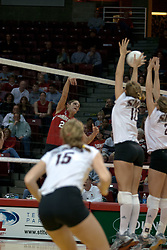06 November 2004....Redbird Savannah Knowles takes a shot at a kill.....Illinois State University Redbirds V SouthWest Missouri State University Bears Volleyball.  Redbird Arena, Illinois State University, Normal IL..Illinois State Redbirds v Southwest Missouri State