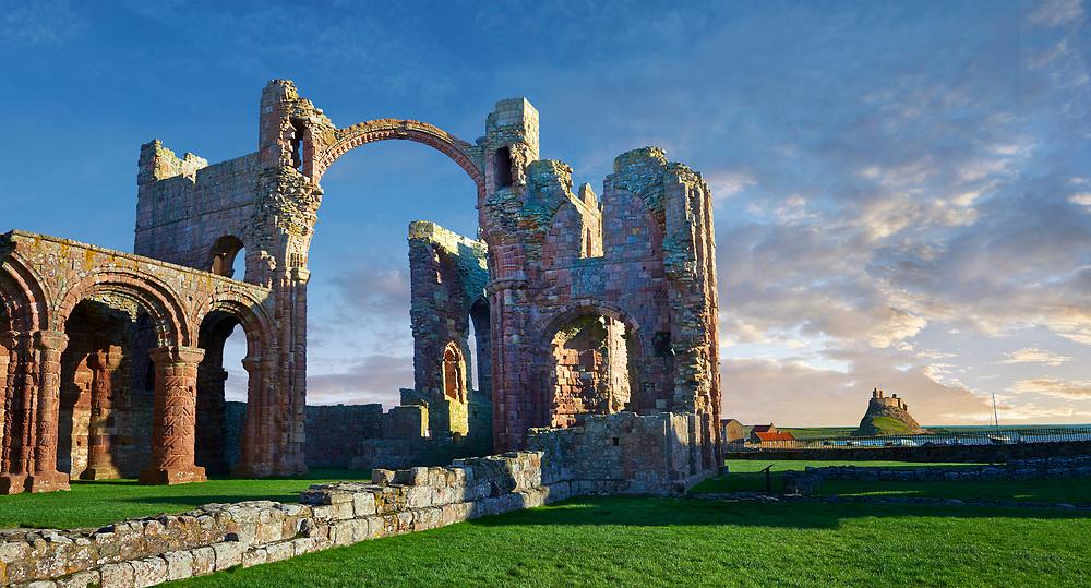 The Anglo Saxon Romanesque Lindisfarne Abbey ruins looking to Lidisfarne Castle,  Holy Island, Lindisfarne, Northumbria, England