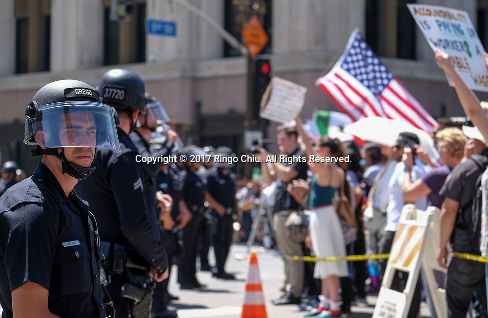 Police officers separate the May Day protesters, right, and a group of President Donald Trump supporters as they taunt each other during the annual May Day March in Los Angeles, May 1, 2017. (Photo by Ringo Chiu/PHOTOFORMULA.com)<br /> <br /> Usage Notes: This content is intended for editorial use only. For other uses, additional clearances may be required.