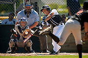 Devin Kluss of the Coeur d'Alene All-Stars takes a hard cut at a pitch during the first inning of their 8-3 victory over Post Falls in the Masters Little League Championship game on Sunday.