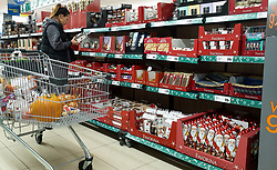 © Licensed to London News Pictures. 14/10/2021. London, UK. A shopper looks at Christmas candy, cakes, chocolate and baked goods in Lidl, north London, amid fears of Christmas food shortages. Retail leaders warn that families should start to shop for Christmas now, amid fears that there may be shortage of presents, food, toys, electrical goods and other products, due to a shortage of HGV lorry drivers. Photo credit: Dinendra Haria/LNP