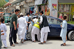July 19, 2017 - Pakistan - QUETTA, PAKISTAN, JUL 19: People are shifting dead bodies victims of firing incident, who .were injured by unidentified armed assailants at Mustang area, in Quetta on Wednesday, July 19, .2017. (Credit Image: © PPI via ZUMA Wire)