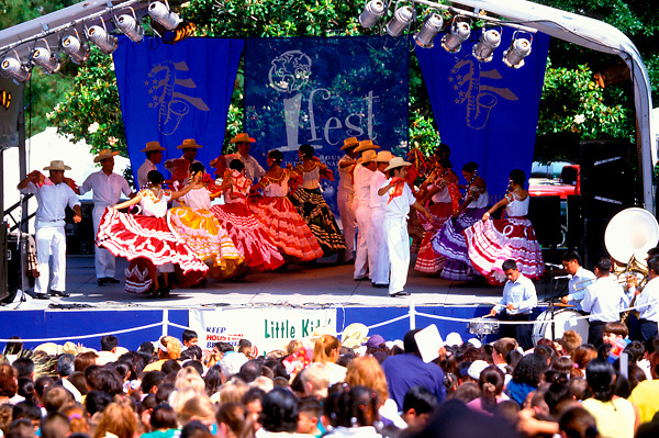 Stock photo of group of men and women in traditional Mexican attire at the International Festival in downtown Houston Texas