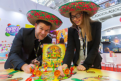 The boardgames Señor Pepper is demonstrated by University Games staff at the Toy Fair at Kensington Olympia in London. It is the UK's largest dedicated game and hobby exhibition featuring the hottest and most anticipated products for the year ahead. London, January 22 2019.
