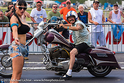 At the drag strip, Annie Chevelle is the starter girl with Bean're on the line Friday afternoon during the Smokeout. Rockingham, NC. USA. June 19, 2015.  Photography ©2015 Michael Lichter.