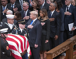 Dignitaries pay their respects as the casket containing the remains of the late former United States President George H.W. Bush at the National funeral service in his honor at the Washington National Cathedral in Washington, DC on Wednesday, December 5, 2018. Front row: United States President Donald J. Trump, first lady Melania Trump, former US President Barack Obama, and former US President Bill Clinton. Second row: former US Vice President Dan Quayle and Marilyn Quayle. Photo by Ron Sachs / CNP/ABACAPRESS.COM