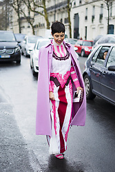 March 4, 2018 - Paris, France - Chrisa Pappas wears a pink coat, a pink pattern dress with glitter and embroidery, outside Valentino, during Paris Fashion Week Womenswear Fall/Winter 2018/2019, on March 4, 2018 in Paris, France. (Credit Image: © Nataliya Petrova/NurPhoto via ZUMA Press)