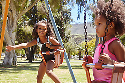 February 19, 2017 - Two young sisters playing on park swings (Credit Image: © Cultura via ZUMA Press)