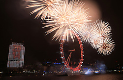 © Licensed to London News Pictures. London, UK. A display of stunning pyrotechnics at the New Year's Eve 2013 Fireworks in central London as the Big Ben's clock strikes 12 to welcome the new year 2014.