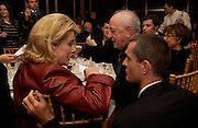 Catherine Deneuve, Rupert Everett and Pierre Berge in the background, Aids beneft during couture week, Pavilion D'Armee Nonville, 21 January 2004. © Copyright Photograph by Dafydd Jones 66 Stockwell Park Rd. London SW9 0DA Tel 020 7733 0108 www.dafjones.com