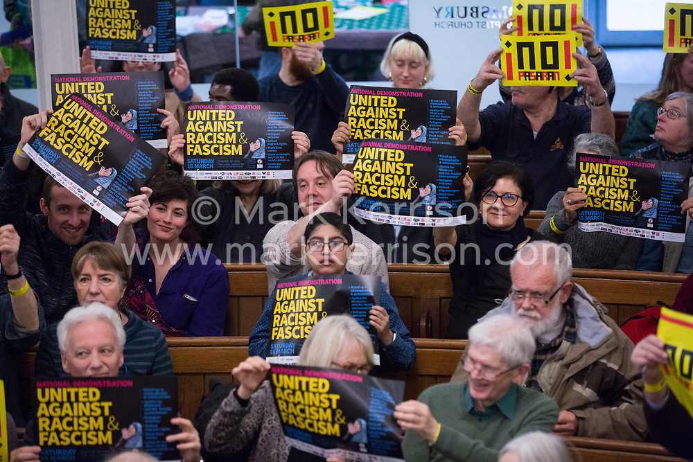 London, UK. 2nd March, 2019. The audience hold up anti-racist messages at the ¡No Pasaran! Confronting the Rise of the Far-Right conference at Bloomsbury Central.