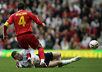 Photo: Paul Thomas.<br /> England v Macedonia. UEFA European Championships 2008 Qualifying. 07/10/2006.<br /> <br /> Wayne Rooney (Bottom) slides in to tackle Goce Sedloski.